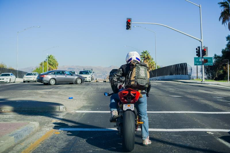 December 6, 2017 San Jose / CA / USA - Motorcyclist waiting at a traffic light, south San Francisco bay area stock photography