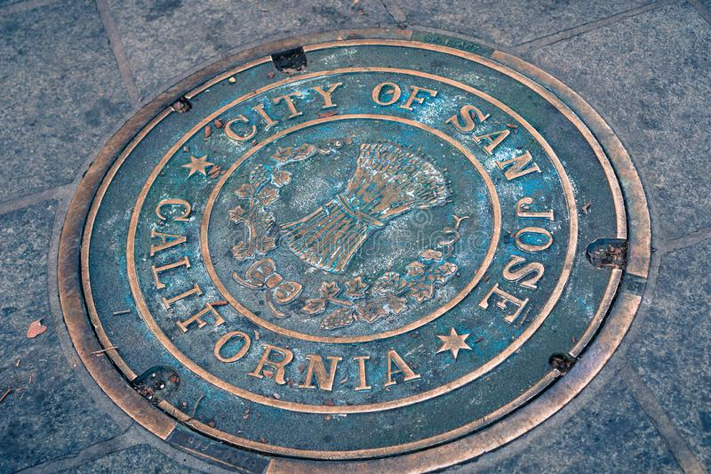 December 7, 2017 San Jose / California / USA: Close up of a City of San Jose Manhole Cover on the sidewalk in the downtown area royalty free stock photo
