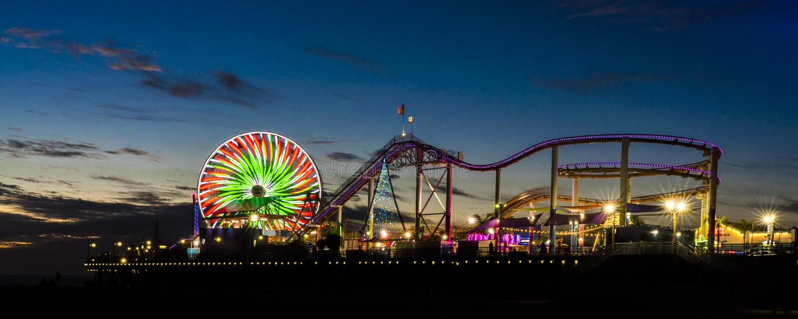 DECEMBER 20, 2018 - SANTA MONICA, CALIFORNIA, USA - Santa Monica Pier with Ferris Wheel and neon lights at sunset, Santa Monica, C. A stock image