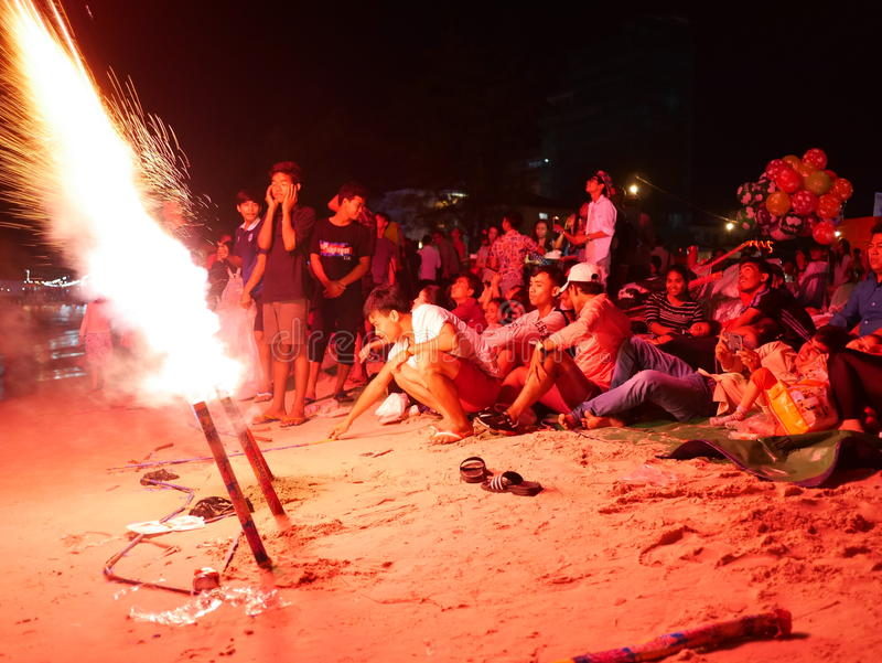 31 december 2016 sihanoukville beach cambodia, group of asian people illuminated by exploding fireworks editorial royalty free stock photography