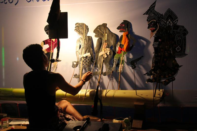 December 22, 2015 - Sukorn island, Trang Province, Thailand: A performer perform Traditional south of Thailand Shadow Puppet Show stock photos
