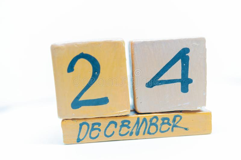 December 24th. Day 24 of month, calendar on wooden background. Handmade calendar stock photo