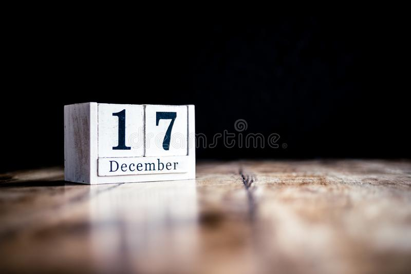 December 17th, 17 December, Seventeenth of December - White block calendar on vintage table - Date on dark background stock photos