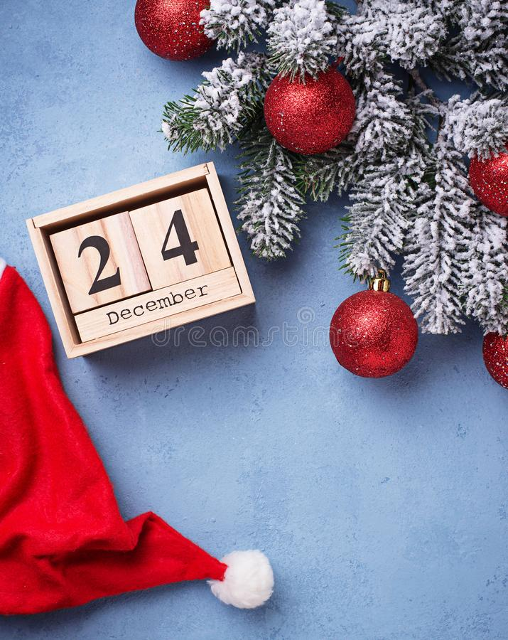 24 December on wooden calendar. Concept of Christmas eve royalty free stock image