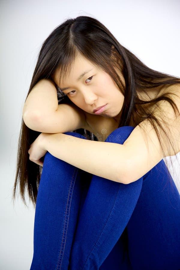 Decepcionado triste de la mujer asiática agujereado fotografía de archivo libre de regalías