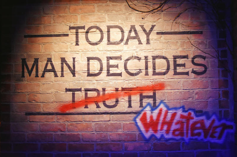 Deception. A Brick Wall at the Creation Museum in Florence, Kentucky that says, `Today Man Decides Truth` But the Truth is crossed off in Red and graffiti words royalty free stock photography