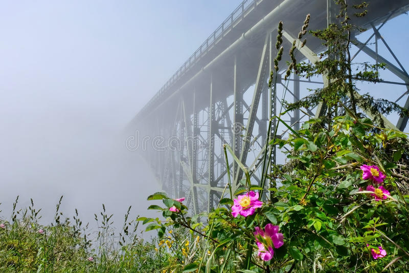 Deception Pass Bridge in fog. Arch bridge in Deception Pass State Park. Puget Sound. Juan de Fuca Strait. Whidbey Island. Seattle. Washington. United States stock photos