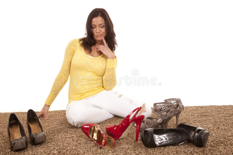 Deciding which shoe to wear royalty free stock image