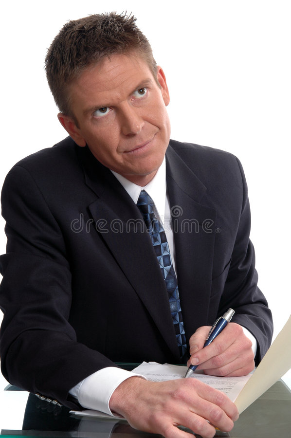 Decision. A businessman debating if he should sign a contract royalty free stock photography