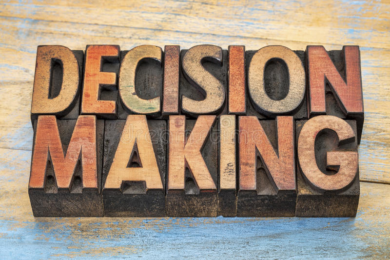 Decision making words in letterpress wood type. Decision making word abstract - text vintage letterpress wood type printing blocks stained by color inks royalty free stock images