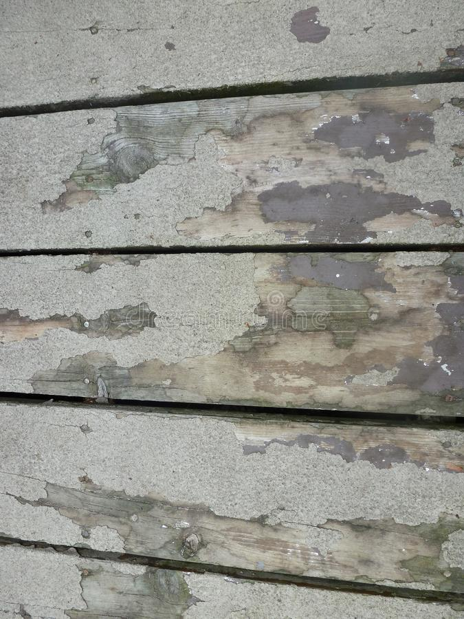 Deck boards. These deck boards display years of wear and many layers of paint royalty free stock image