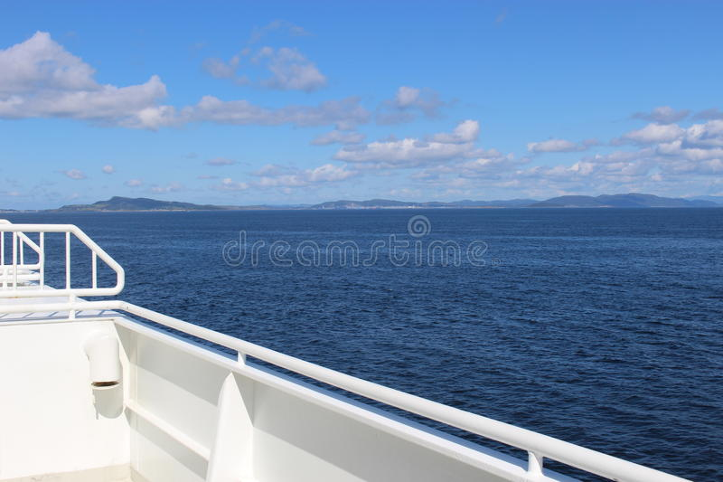 On the deck of a car ferry in Norway, Europe. The ship is passing the Fjord Boknafjorden stock images