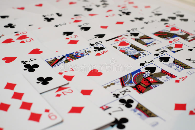 Deck of cards and ace of heart stock photos