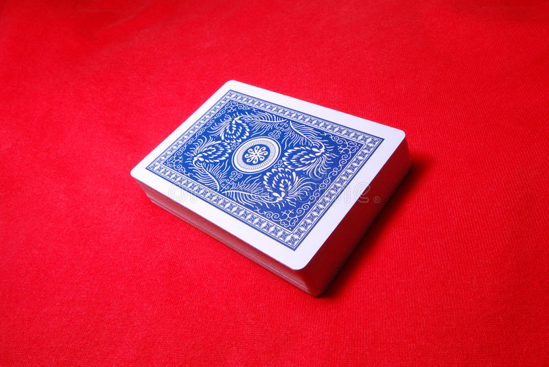 A Deck Of Cards. A deck of poker cards against a red backdrop royalty free stock images