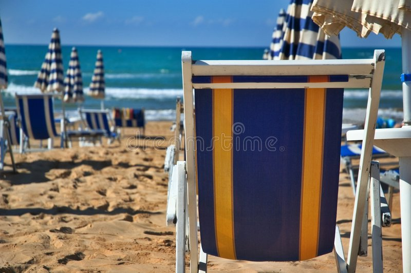 Deck chair on the beach royalty free stock photo