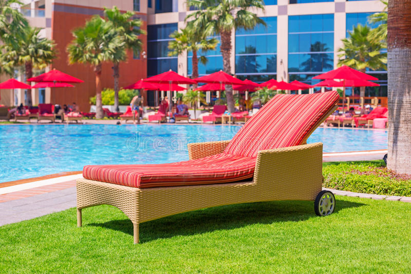 Deck chair at the swimming pool royalty free stock photo