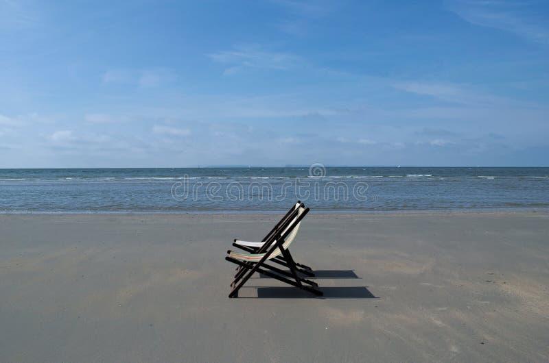 Deck chairs on the beach. stock photos