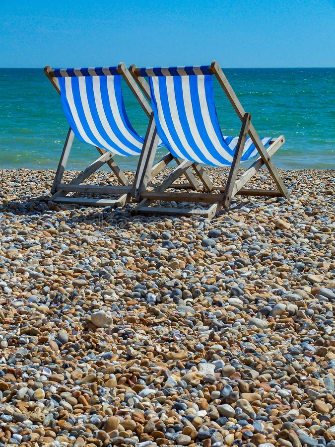 Deck Chairs on Beach stock image