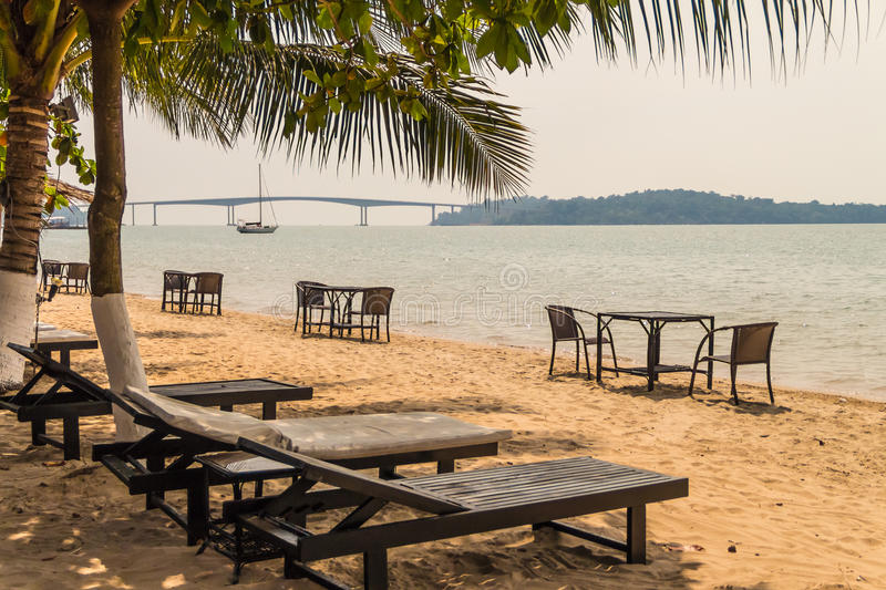 Deck chairs on the beautiful tropical beach royalty free stock photo
