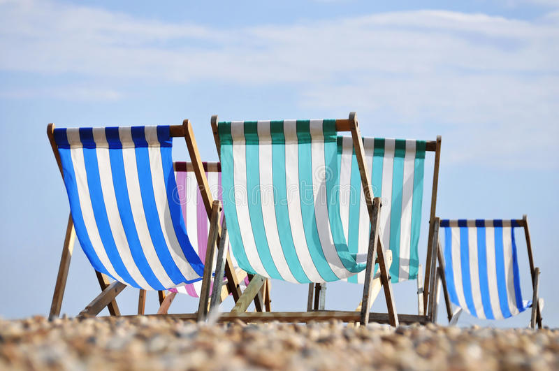 Deck chairs on Brighton beach stock image