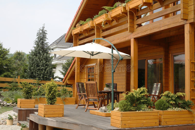 Deck on country house. A view of an open deck and deck furniture on a large rustic, country house stock photo