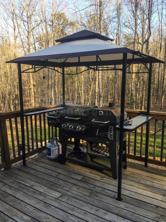Deck with grill and covered cooking area stock image