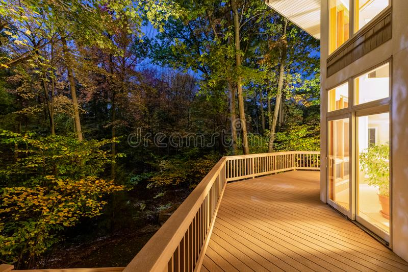 Deck on Home in Woods at Night. Large composite deck on a luxury home in the woods photographed at night.  Concepts could include architecture, design, outdoor stock photos