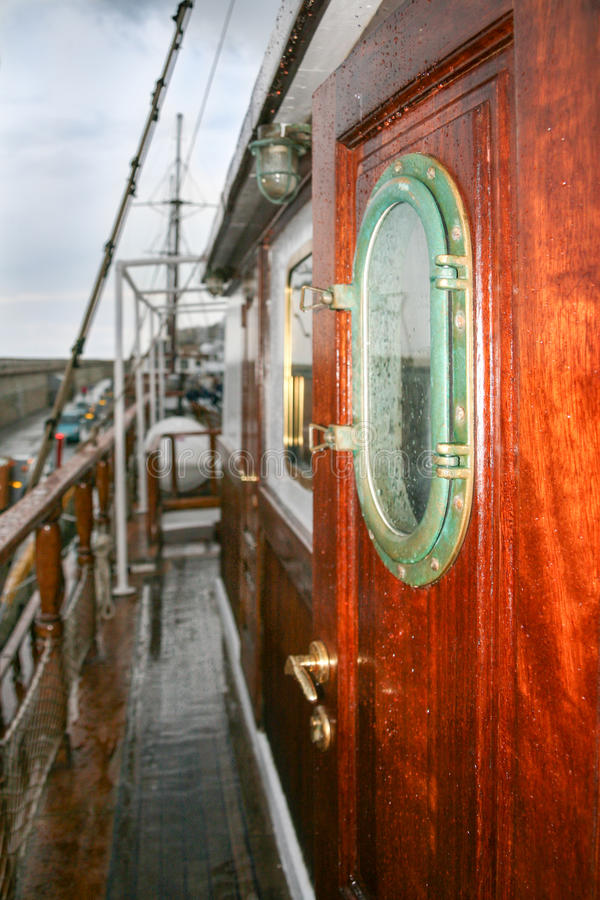 Deck and portholes. Wooden cruise yacht deck and porthole royalty free stock photography