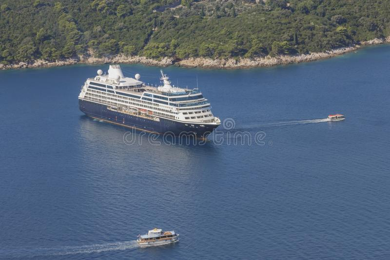 Deck ship anchored in the bay before the insel Lokrum in the Adriatic Sea near the city Dubrovnik. Sea travel in Croatia. Sea stock photography