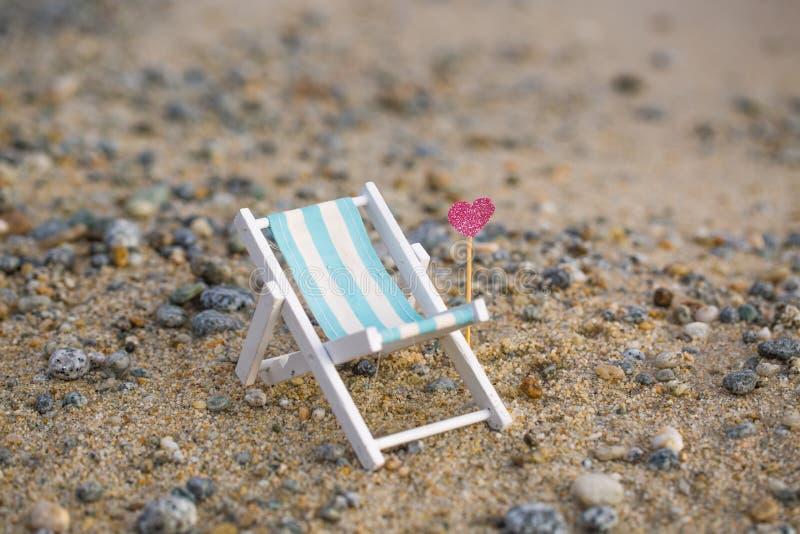 Deckchair на пляже, ослабляет стоковые фото