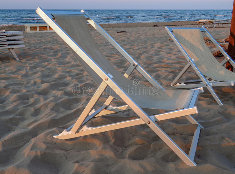 Deckchair на пляже стоковая фотография rf
