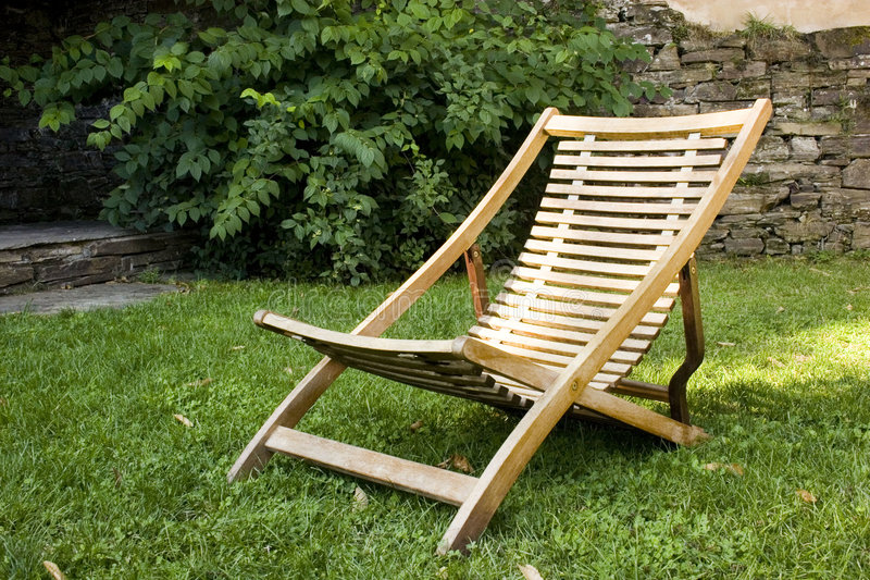 Deckchair. On the grass in the garden royalty free stock photos