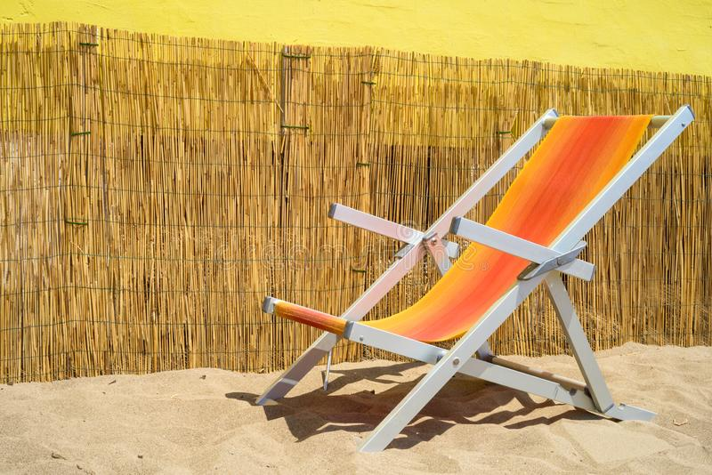 Deckchair on sand. Colorful deckchair in an italian beach royalty free stock photography