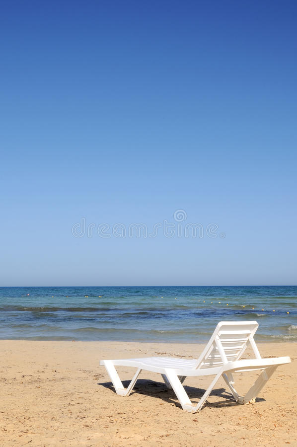 Download Deckchairs On The Beach Under Blue Sky Stock Image - Image: 14897909