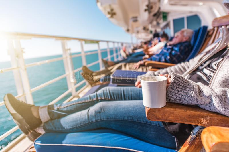 Deckchairs Cruise Ship Relax. Cruise Guest Relaxing in the Sun. Commercial Maritime Theme stock photo
