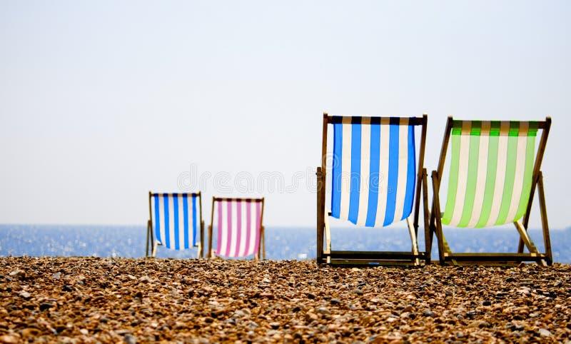 Deckchairs op het strand royalty-vrije stock foto