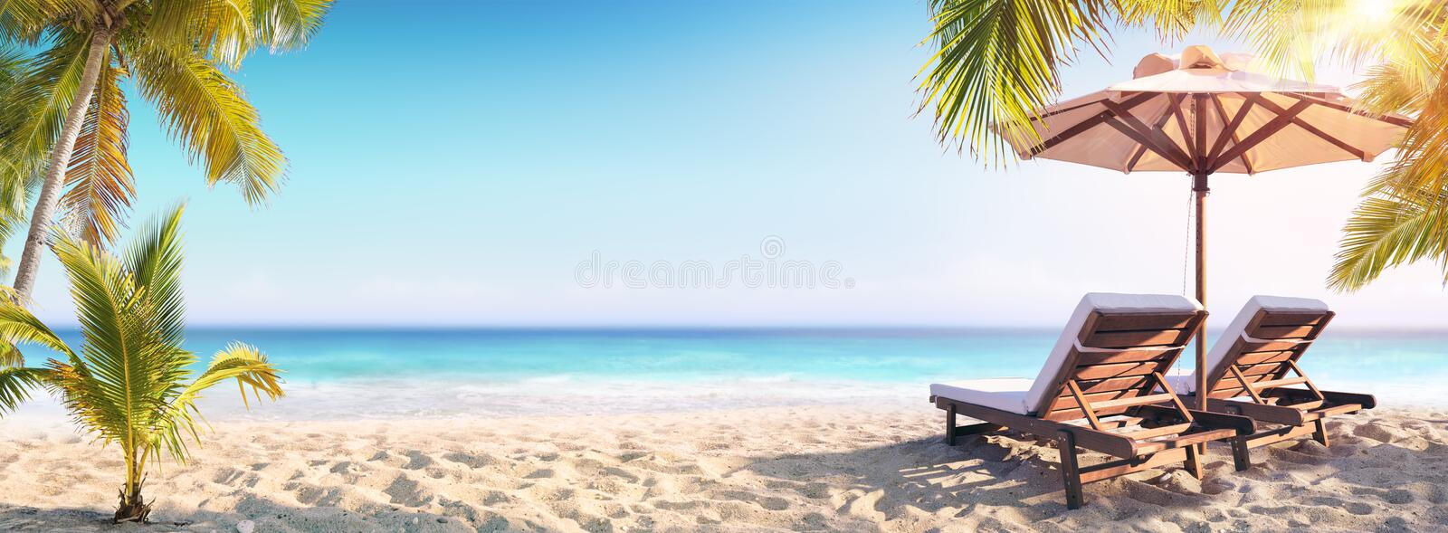 Deckchairs And Parasol With Palm Trees royalty free stock photo