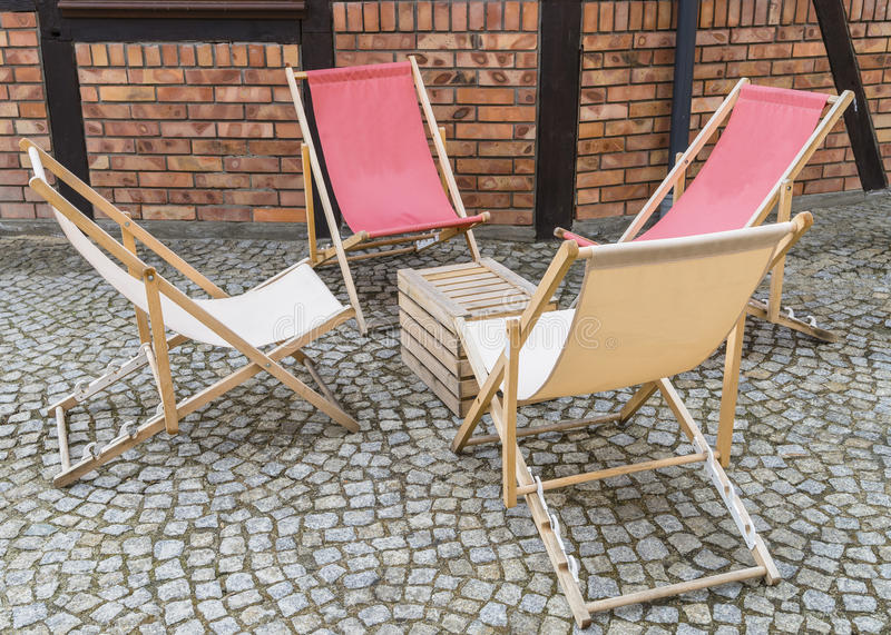 Deckchairs on street royalty free stock photos