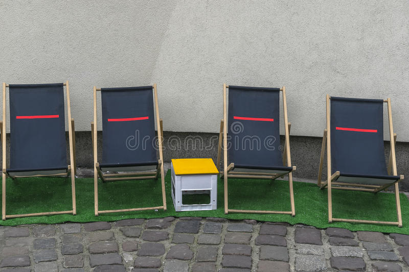 Deckchairs on street royalty free stock photography