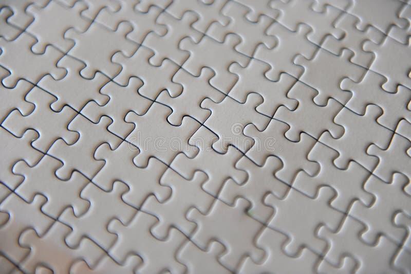 Decken Sie Puzzlespiel ab stockfotos