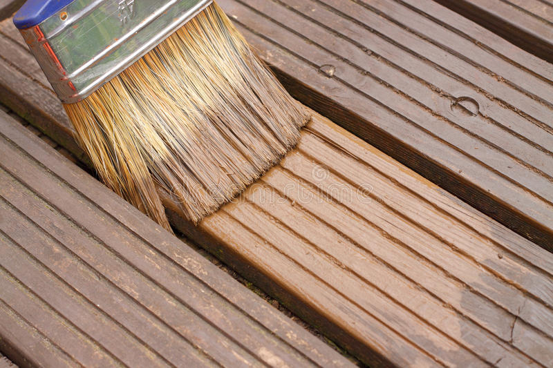 Decking painting staining stock photography
