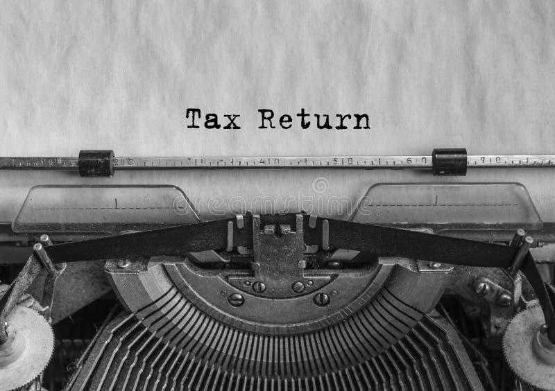 Declaração de imposto, texto datilografado lei posicione imagens de stock royalty free