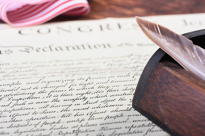 Declaration. The ancient text of the declaration on independence of the United States of America with a casket and a feather for the write royalty free stock photos