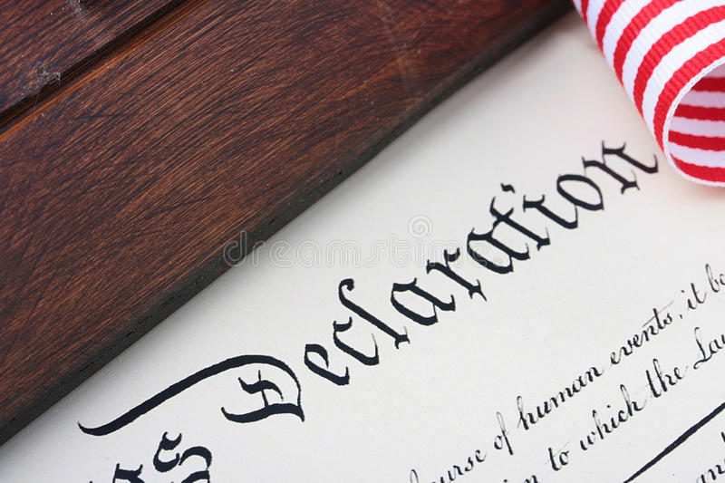 Declaration. The ancient text of the declaration on independence of the United States of America with a casket and a feather for the write royalty free stock images