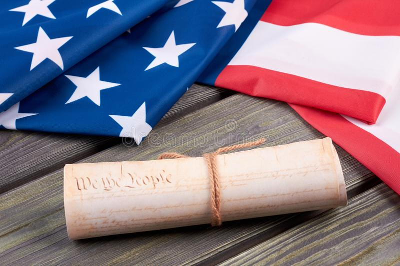 Declaration of the Independence of the United States. Close up vintage constitution of the USA and USA flag on wooden background. Documents of the country royalty free stock photos
