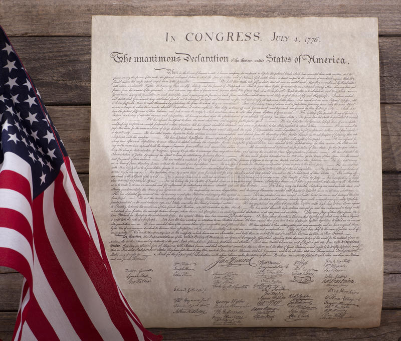 Declaration of Independence. With United States flag on a wood background stock images