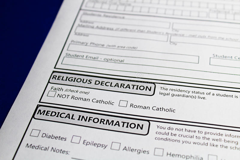 Declaring faith to attend a catholic school in order to receive funding.  royalty free stock images