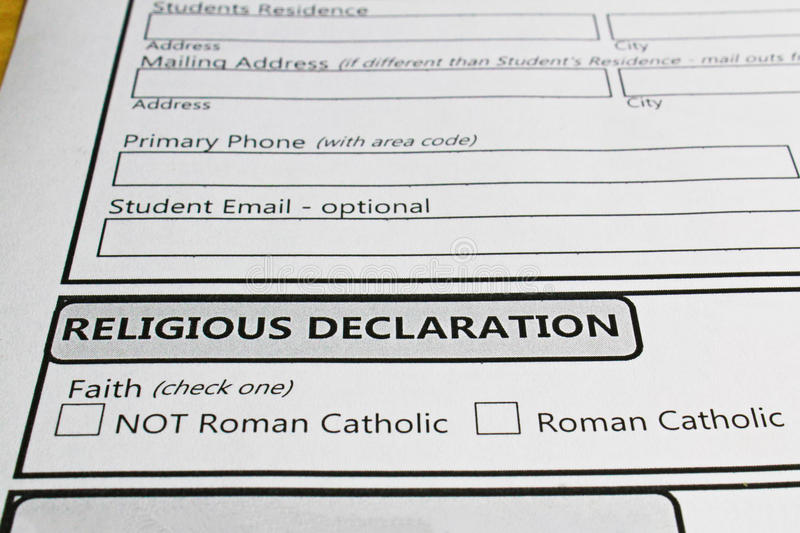 Declaring ones faith in order to attend a catholic school.  stock images