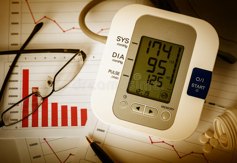 Decline charts and high blood pressure. stock photo