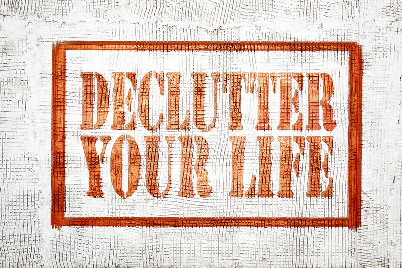 Declutter your life - graffiti style sign. On stucco wall stock images